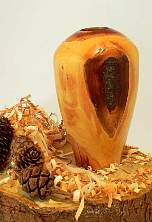 Image of an Damson hollow vessel made by Chris Rymer of Inside Out Wood Art