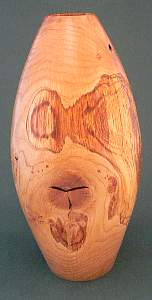 Image of an Oak hollow vessel made by Chris Rymer of Inside Out Wood Art
