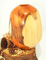 Image of an Yew hollow vessel made by Chris Rymer of Inside Out Wood Art